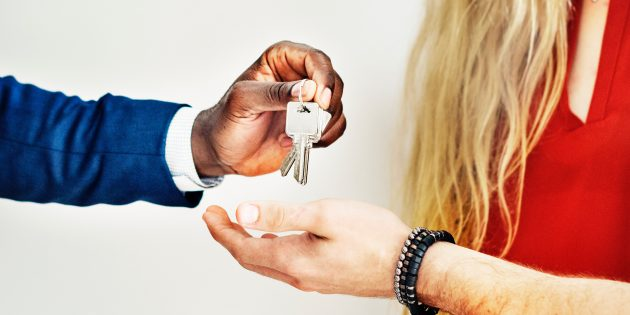 Photo: Landlord Handing Keys to Tenant