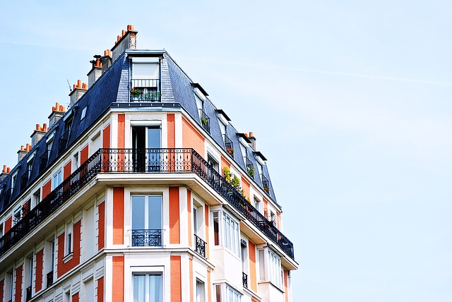 European-style red apartment building with black wrought iron balcony