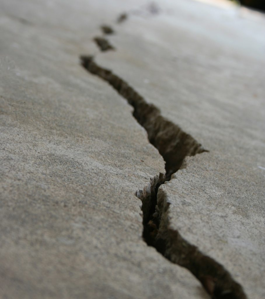 large fissure in grey cement