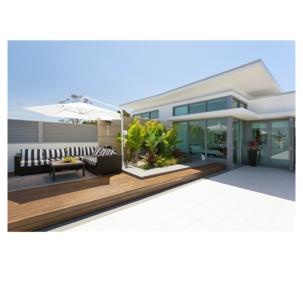 patio of modern style house with black and white furniture, a large white sun umbrella and small decorative palm trees