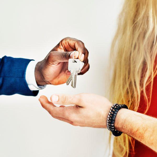 Photo: Landlord Handing Keys to Tenant