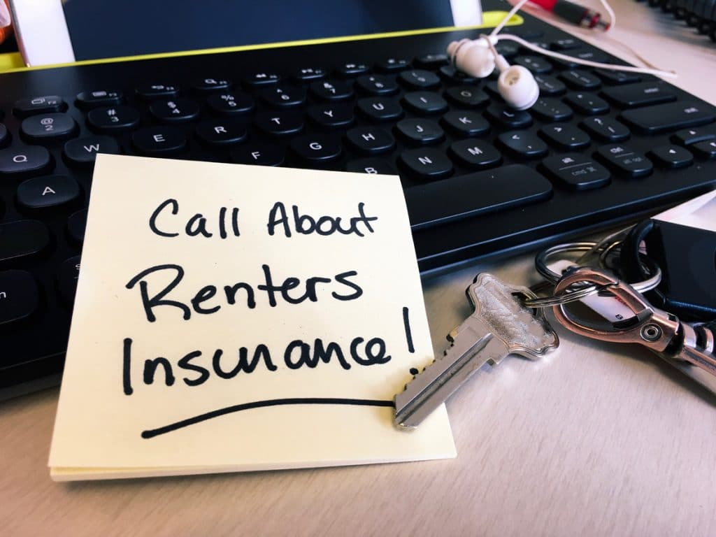renters insurance note on keyboard