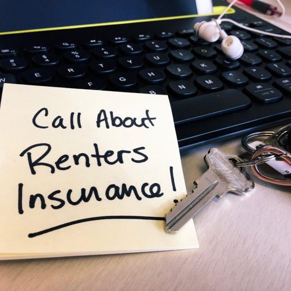 renters insurance note on keyboard